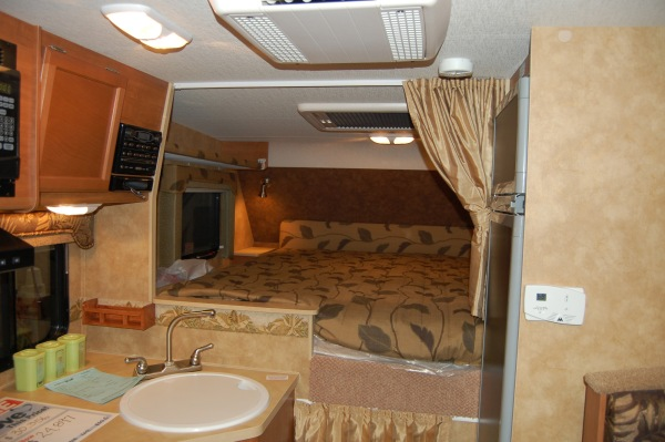 Note the new hatch above the bed ... with a little curtain.