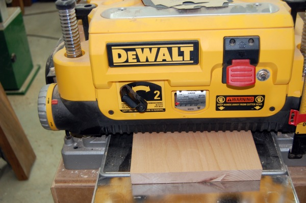 A planer ... keep feeding it through until you get the thickness you want.